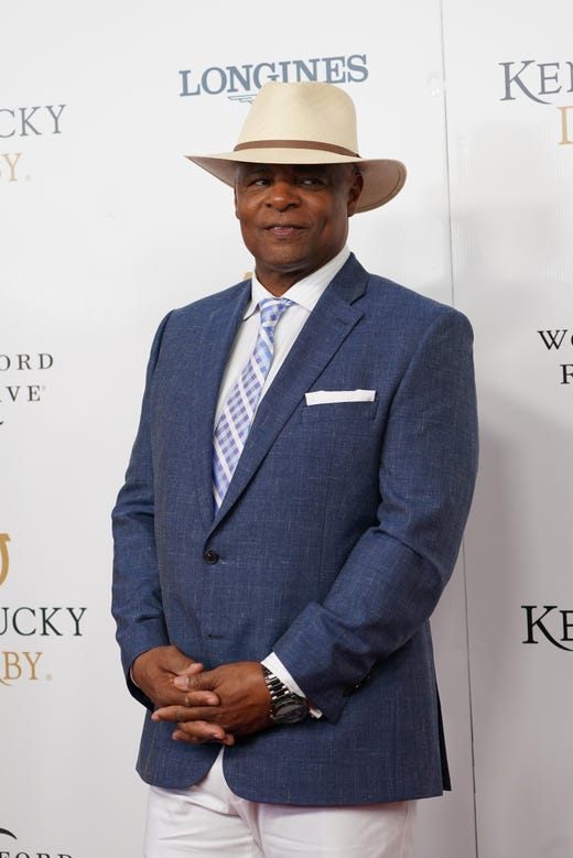 Former NFL quarterback Warren Moon arrives on the red carpet before the 145th running of the Kentucky Derby.