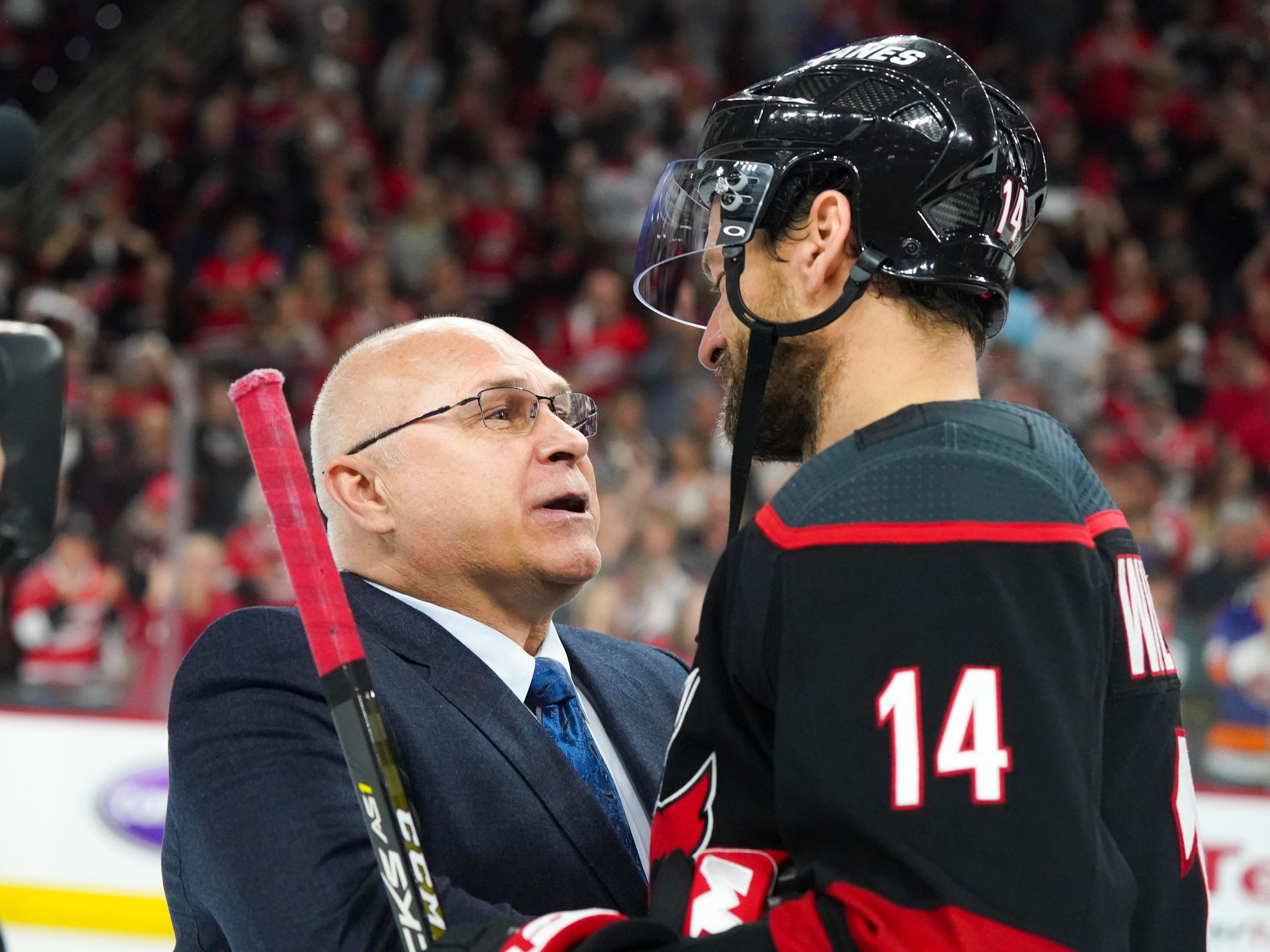 Second round: Islanders coach Barry Trotz and Hurricanes captain Justin Williams after Carolina advanced with a sweep. The two were together with the Capitals.