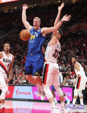 May 3: Denver Nuggets forward Mason Plumlee (24) reacts after being fouled by Portland Trail Blazers forward Zach Collins (33) in the first half of Game 3.