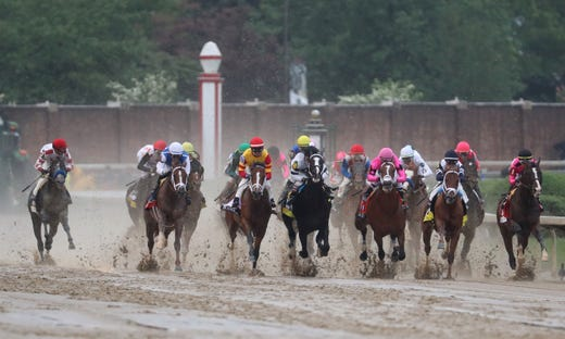 Horses race at the start of the 145th running of the Kentucky Derby at Churchill Downs.