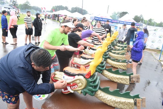 "The heads of dragon boats are symbolically ""awakened"" by painting eyes on them before the 2019 Louisiana Dragon Boat Races."