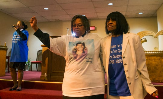 Penny Dees (center) dances along to praise music. Every year Penny Dees held a march asking for justice for her daughter who was murdered in 1992. With a suspect found, and charged but still not convicted, Penny decided to hold a victory celebration instead. With the rain, she held the event at her church, the Asbury Park Deliverance Center.