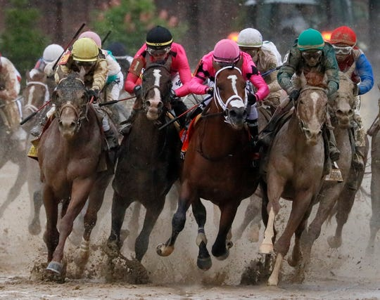Luis Saez riding Maximum Security, second from right, goes around turn four with Flavien Prat riding Country House, left, Tyler Gaffalione riding War of Will and John Velazquez riding Code of Honor, right, during the 145th running of the Kentucky Derby horse race at Churchill Downs Saturday, May 4, 2019, in Louisville, Ky.