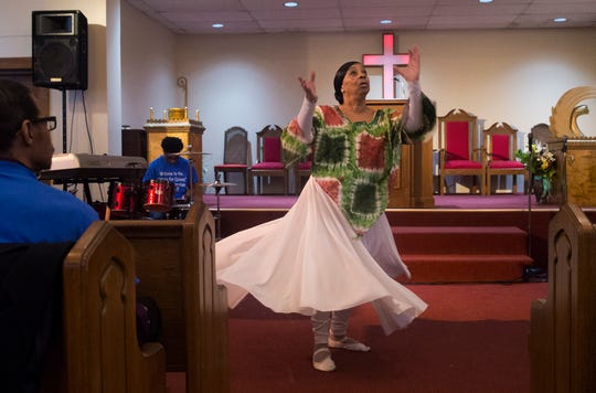 Sandra Dow performs a Praise Dance at the start of service. Every year Penny Dees held a march asking for justice for her daughter who was murdered in 1992. With a suspect found, and charged but still not convicted, Penny decided to hold a victory celebration instead. With the rain, she held the event at her church, the Asbury Park Deliverance Center.