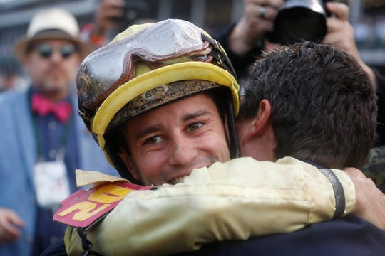 Jockey Flavien Prat celebrates after winning the 145th running of the Kentucky Derby at Churchill Downs.