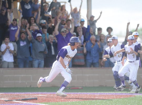Wylie's Tyler Martin yells out after scoring the winning run in the eighth inning of Game 3 of a Region I-5A bi-district series against Lubbock-Cooper on Saturday, May 4, 2019, at Bulldog Field in Abilene.