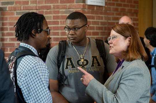 Western Carolina University Chancellor-elect Kelli R. Brown (right) talks to students during a reception following her first address to the campus community.