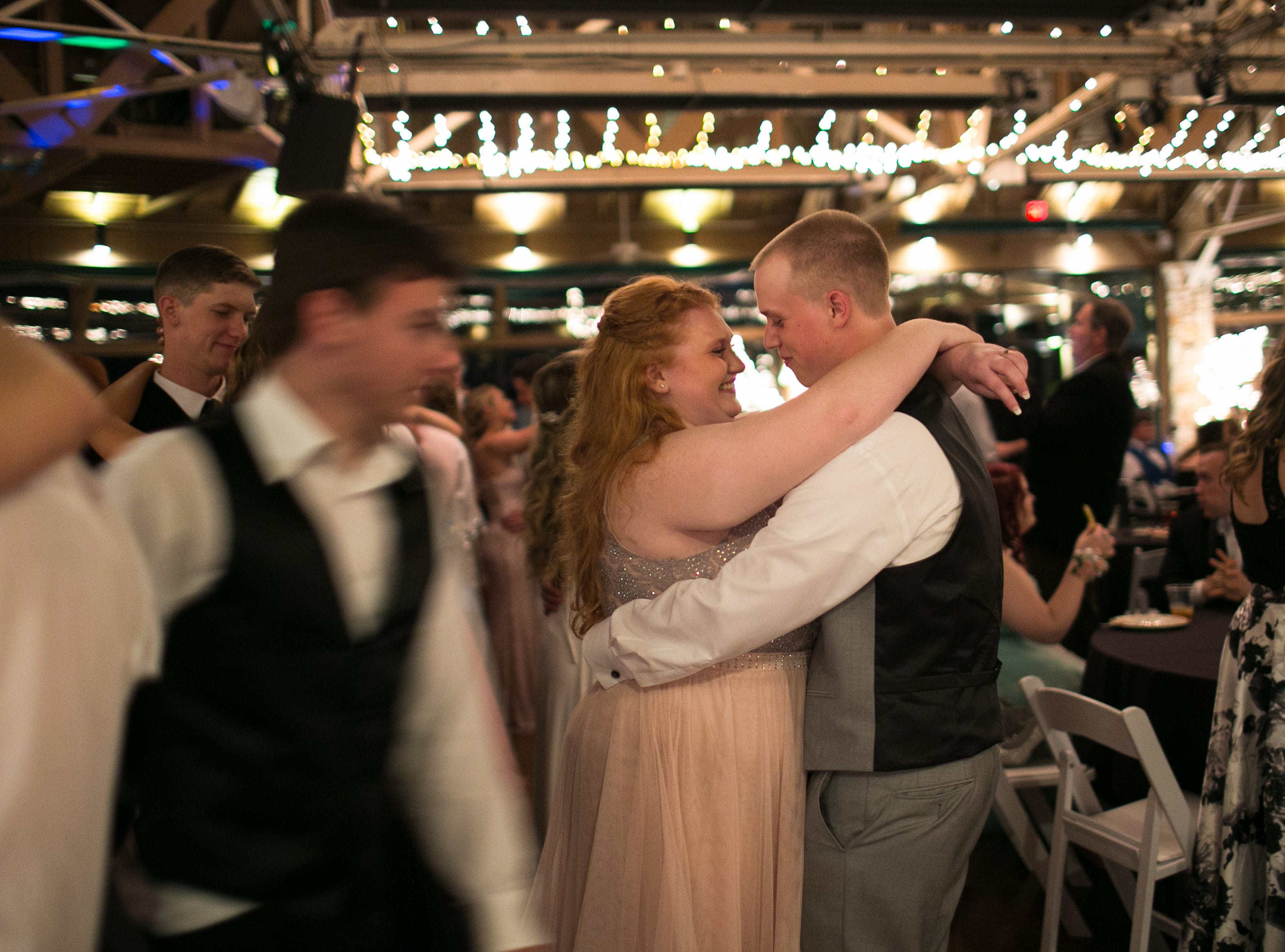 Maddie Honeycutt and Ethan Meadows dance as Madison High School celebrates its prom on May 4, 2019, at the Crest Center Pavilion.