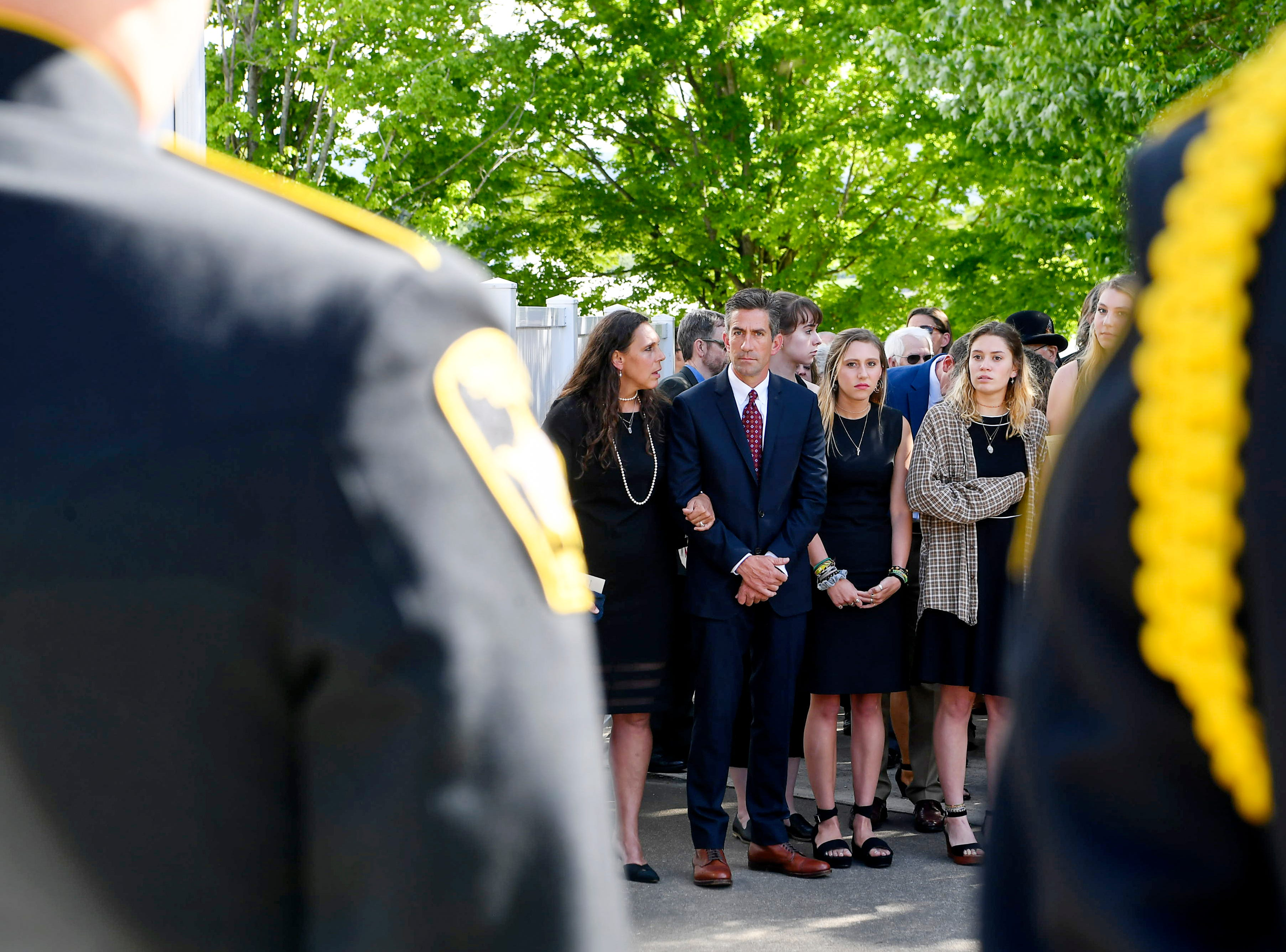 Family and friends watch as Riley Howell is carried into Stuart Auditorium in Lake Junaluksa May 5, 2019.