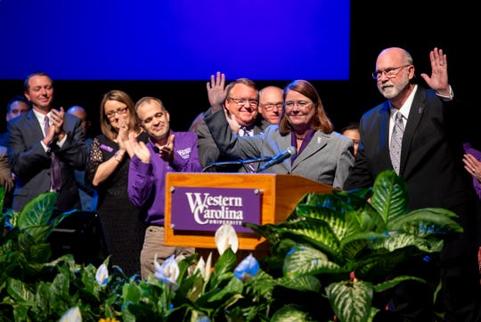 Western Carolina University Chancellor-elect Kelli R. Brown and her husband, Dennis, wave to the crowd as they are introduced to the campus community.