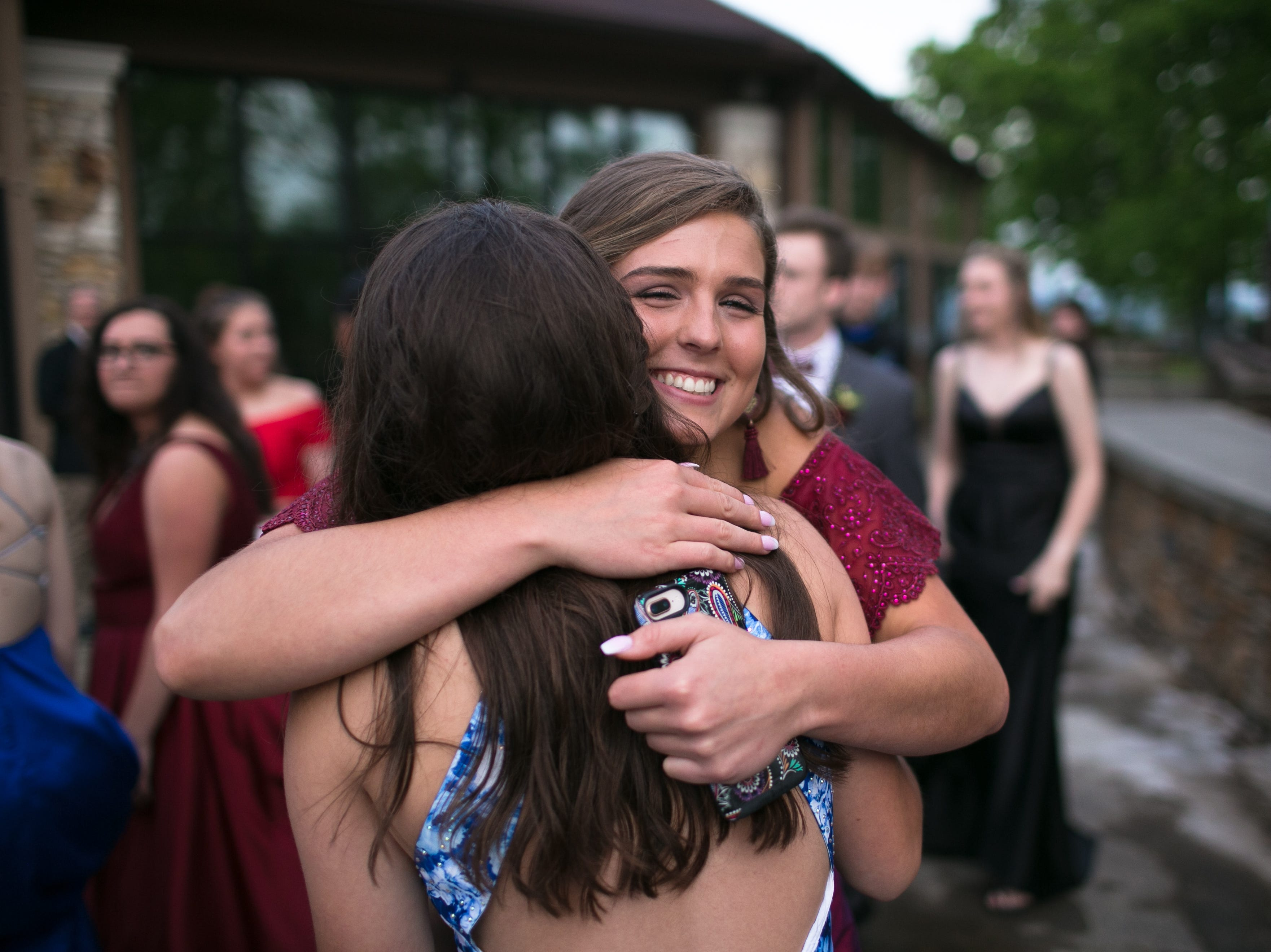 Alex Baker hugs Sadie Worley as Madison High School celebrates its prom on May 4, 2019, at the Crest Center Pavilion.