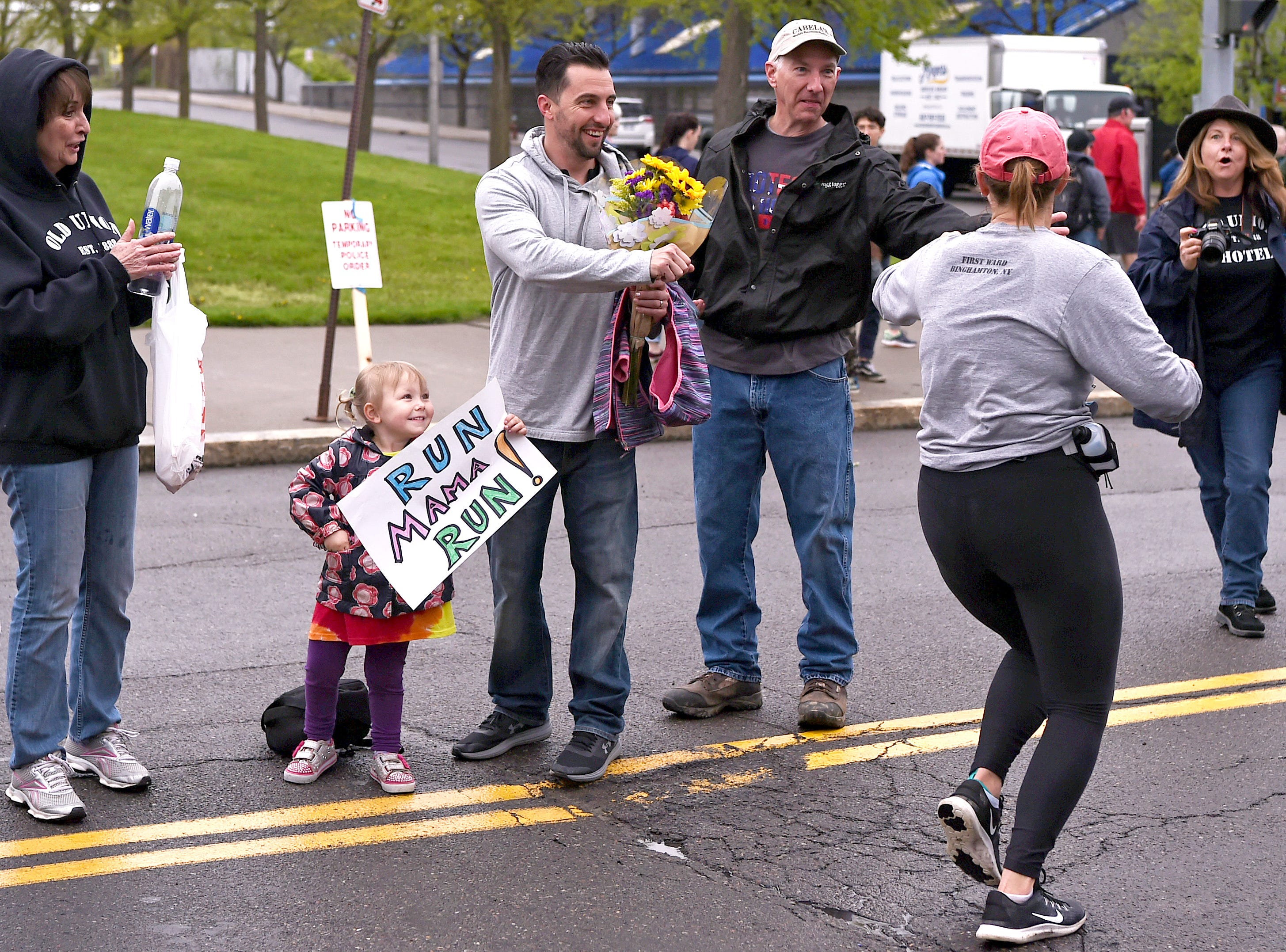 Family and friends cheer on the half marathon runners near the finish line during the Greater Binghamton Bridge Run Half Marathon and 5K, Sunday, May 5, 2019.
