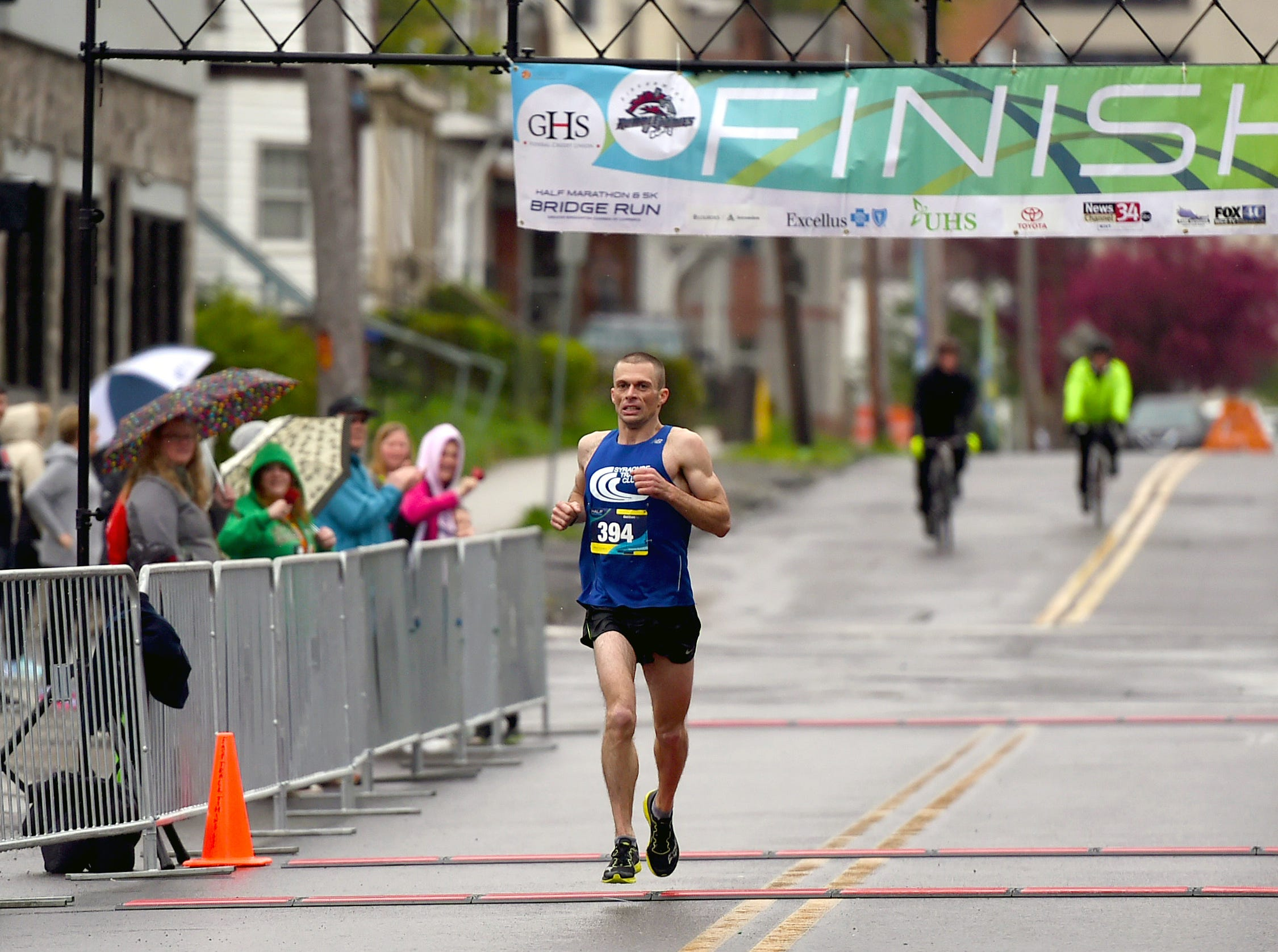 Sam Morse of Camden crosses the finish line of the Greater Binghamton Bridge Run Half Marathon on Sunday, May 5, 2019. Morse finished first and set a course record of 1:08.38.