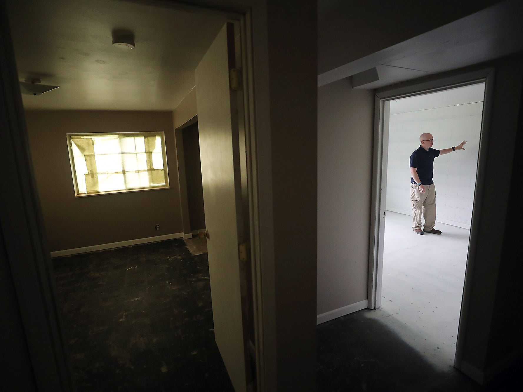 Ryan Barnes talks about the process of cleaning his Port Orchard home after they found out it was contaminated with methamphetamine, on Thursday, May 2, 2019. The basement room he is standing in had the highest concentrations of methamphetamine Ð in order to make it safe again for humans, the room had to be cleaned and painted over .