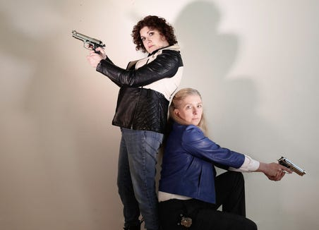 "Stephanie Turcotte (left) and Dawn Janow play detectives in ""27 Short Plays about Being Murdered in a Hotel by ABBA."""
