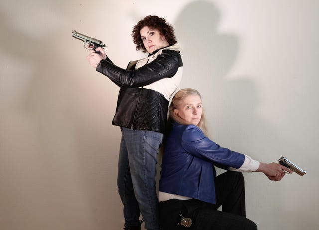 Stephanie Turcotte (left) and Dawn Janow play detectives trying to catch ABBA in the act.