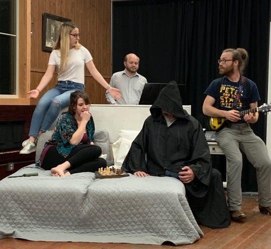 ABBA (from left, Solomia Bishko, Amanda Pease, Jon Brenner and Kristopher Jones) have a meeting with Death (Kyle Guse).