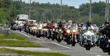 Over a thousand motorcyclists escort the Vietnam Traveling Memorial Wall to Wickham Park for the  annual veterans reunion.