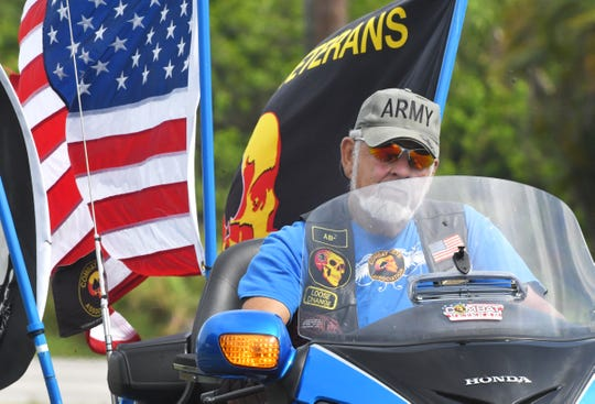 On Sunday, well over a thousand motorcyclists and other vehicles formed a miles long procession to bring the 300 foot Vietnam Traveling Memorial Wall to Wickham Park in Melbourne for the 32nd Vietnam and All Veterans Annual Reunion, May 5-12.