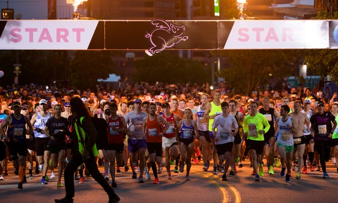 Runners start the 21st annual Flying Pig Marathon Sunday, May 5, 2019.