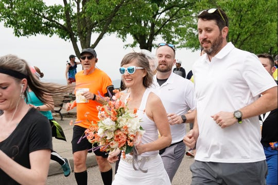 Jason Laine and Jessica Overly were married in Eden Park during the Flying Pig half marathon on May 5, 2019. The wedding was officiated by Eric Barret. The entire wedding party wore matching Asics running shoes