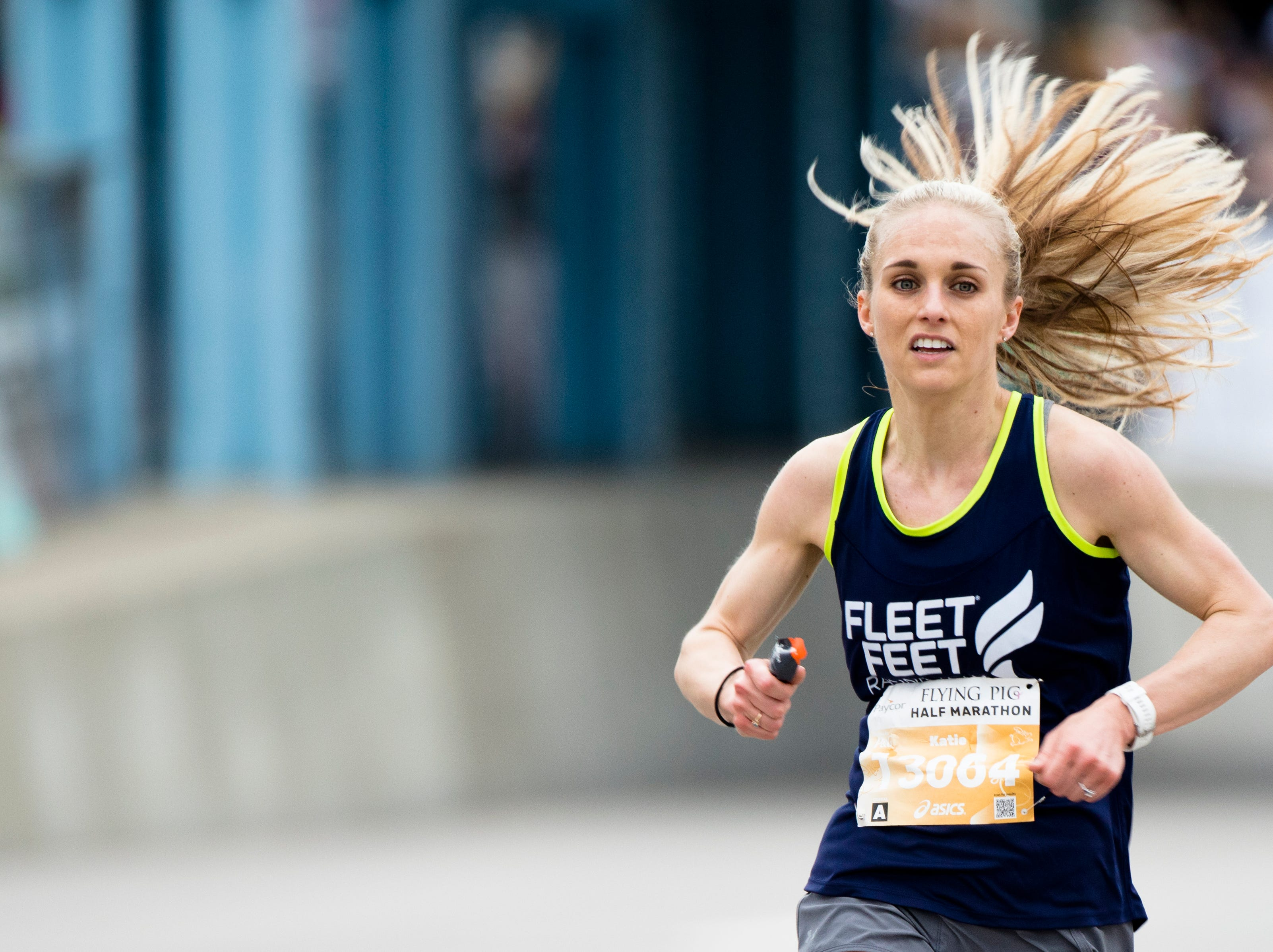 Katie Lenahan, of Cincinnati, finishes the half marathon during the 21st annual Flying Pig Marathon Sunday, May 5, 2019.