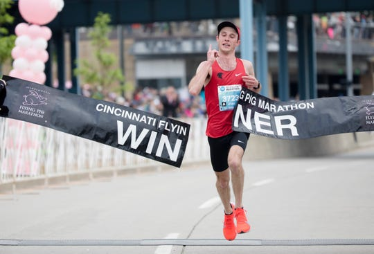 Jack Randall, of Dayton, is the men's winner of the Flying Pig Marathon on May 5, 2019, with a time of 2:28:58.