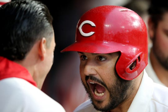 Cincinnati Reds third baseman Eugenio Suarez (7) celebrates a three-run home run with Cincinnati Reds left fielder Derek Dietrich (22) in the second inning during a MLB baseball game, Saturday, May 4, 2019, at Great American Ball Park in Cincinnati.