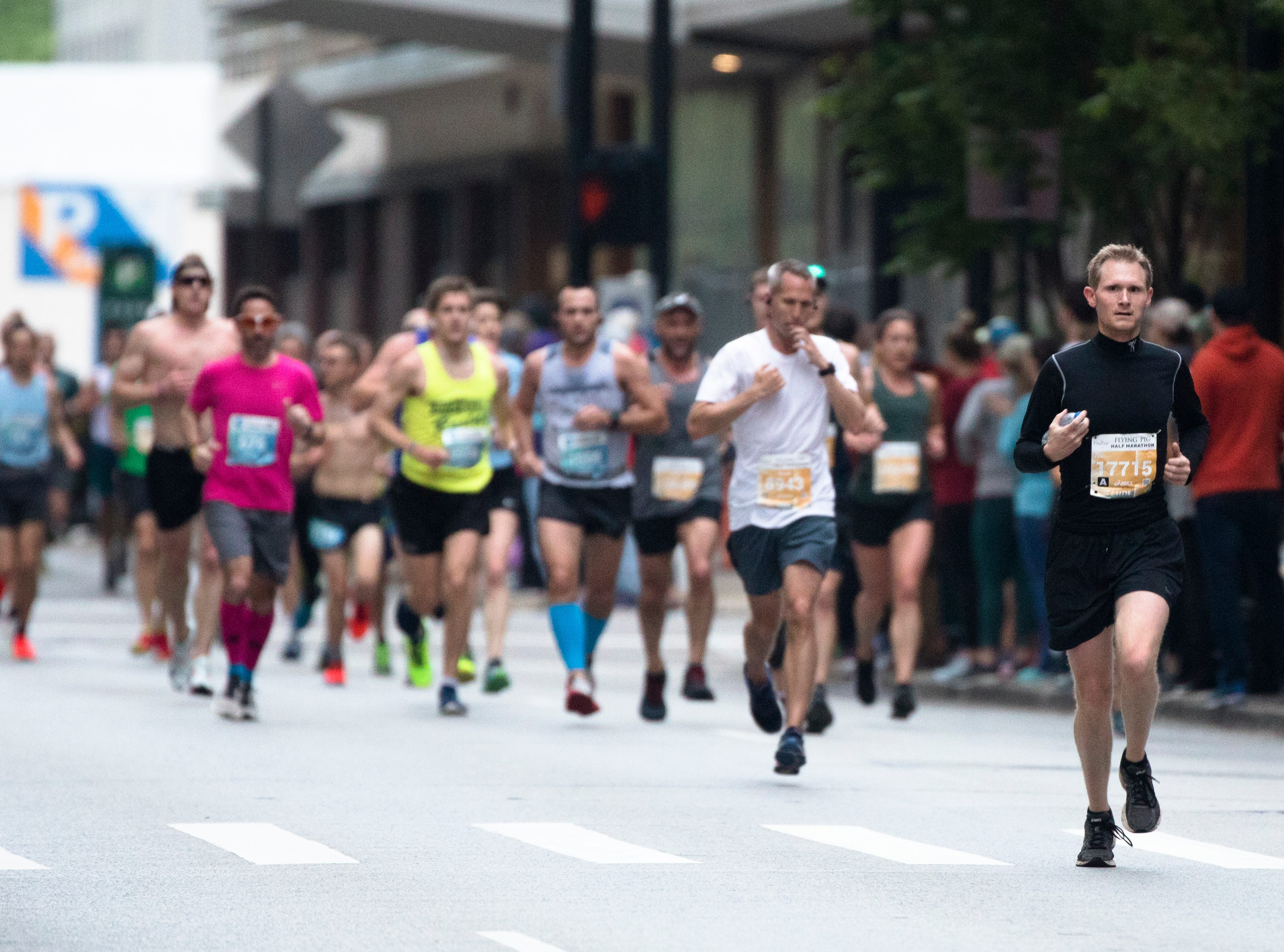 Nicholas Cook, of Liberty Township, runs down 7th street during the 21st annual Flying Pig Marathon Sunday, May 5, 2019.