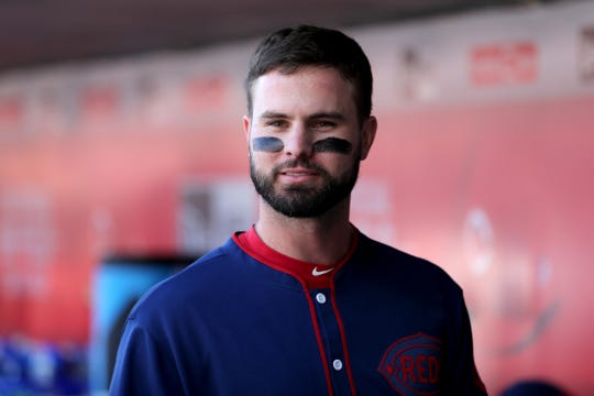 Cincinnati Reds right fielder Jesse Winker (33) walks through the dugout in the second inning during an MLB baseball game against the San Francisco Giants, Sunday, May 5, 2019, at Great American Ball Park in Cincinnati.