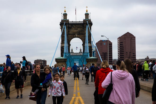 People walk the Roebling Bridge to get a view of the 21st annual Flying Pig Marathon Sunday, May 5, 2019, in Cincinnati.