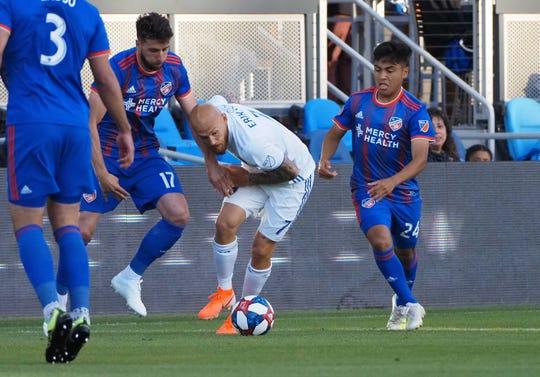 San Jose Earthquakes midfielder Magnus Eriksson (7) controls the ball between FC Cincinnati defender Mathieu Deplagne (17) and midfielder Frankie Amaya (24) during the first half at Avaya Stadium.