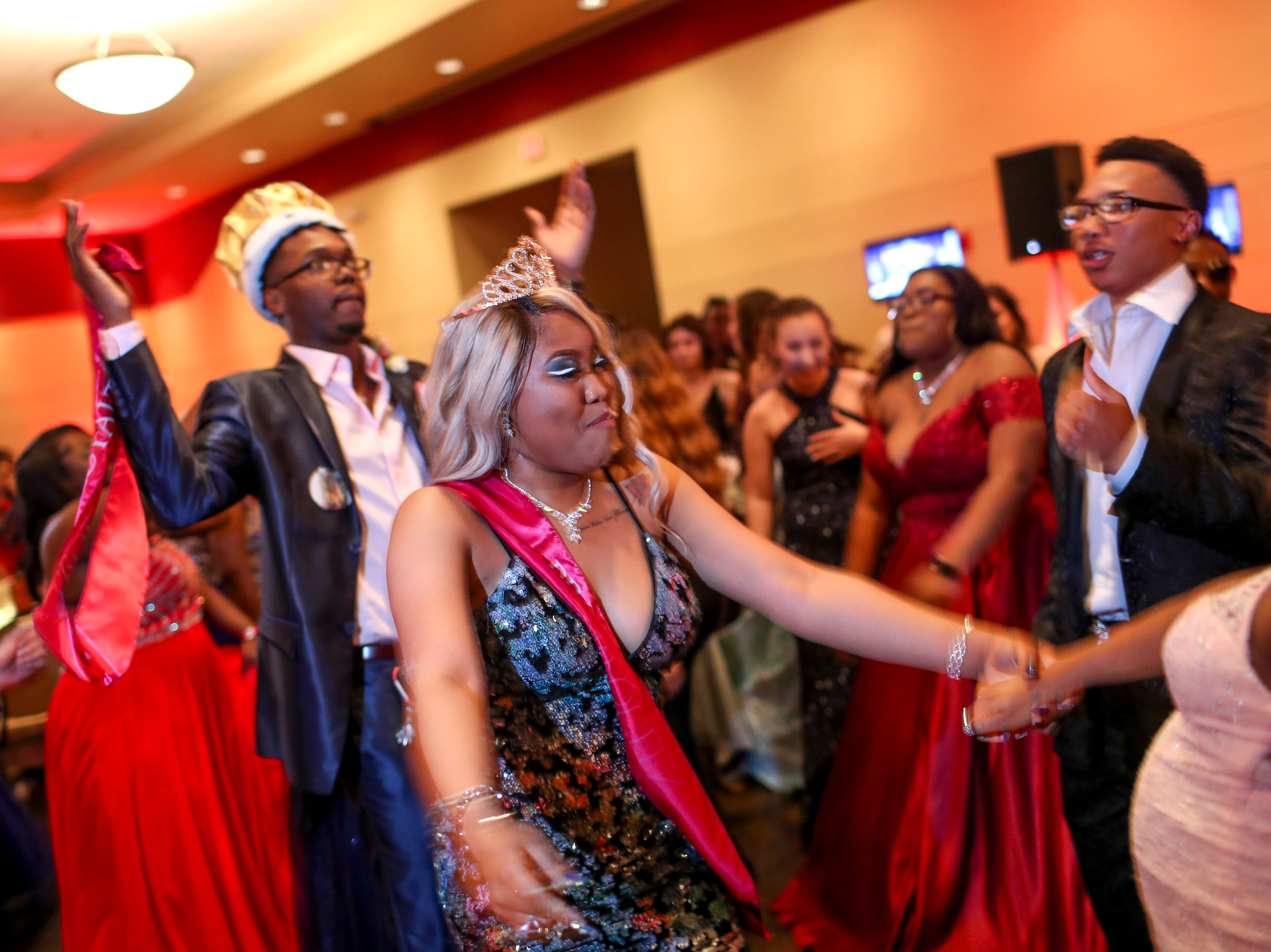 """The prom king and queen are joined by hundreds of students from Kenwood High School celebrated their 2019 prom themed """"Cherish the Moment"""" at Valor Hall in Oak Grove, KY., on Saturday, May 4, 2019."""