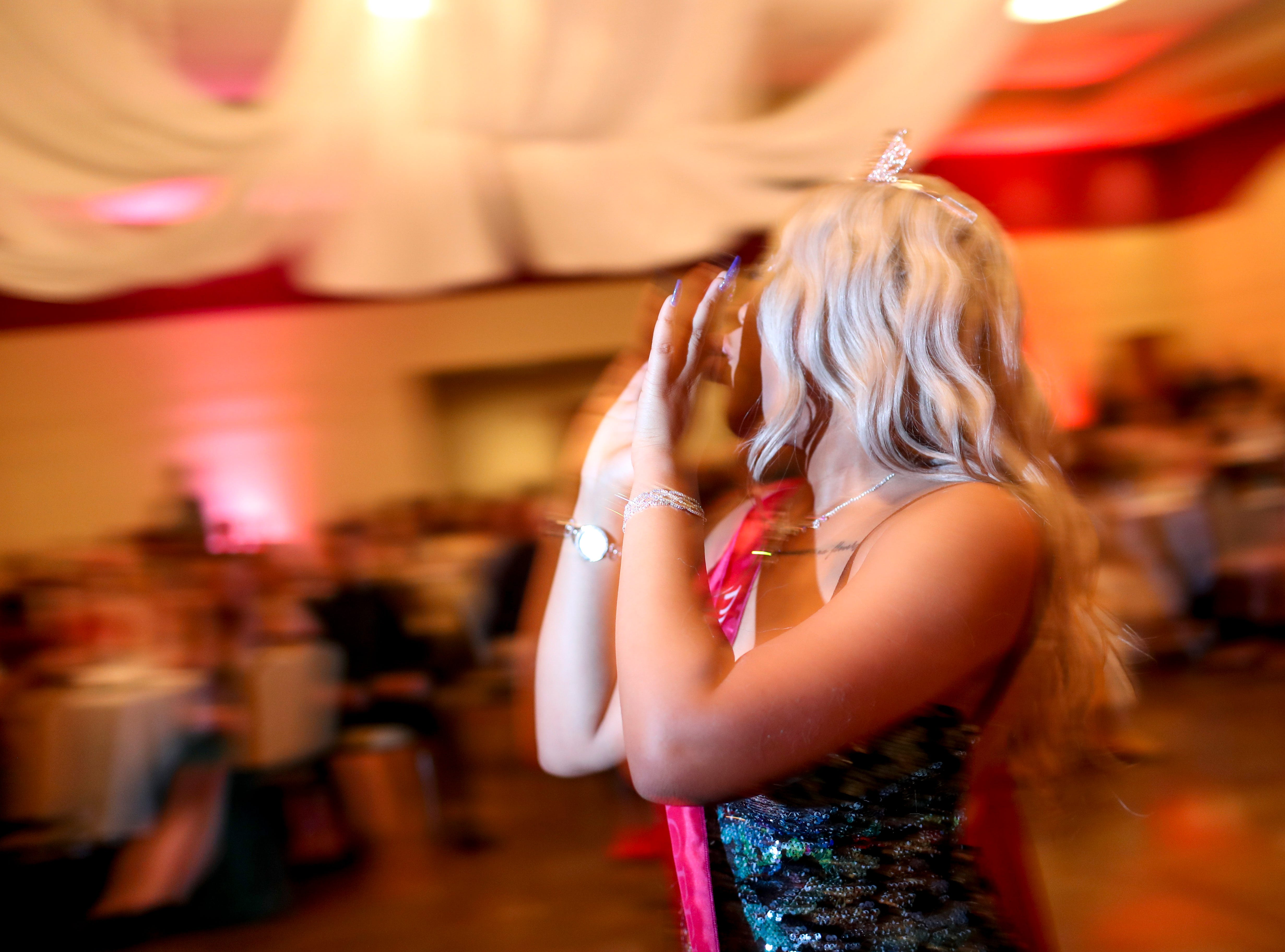 """Prom queen Adannis Delis-Luna dances in the center of the floor while hundreds of students from Kenwood High School celebrated their 2019 prom themed """"Cherish the Moment"""" at Valor Hall in Oak Grove, KY., on Saturday, May 4, 2019."""