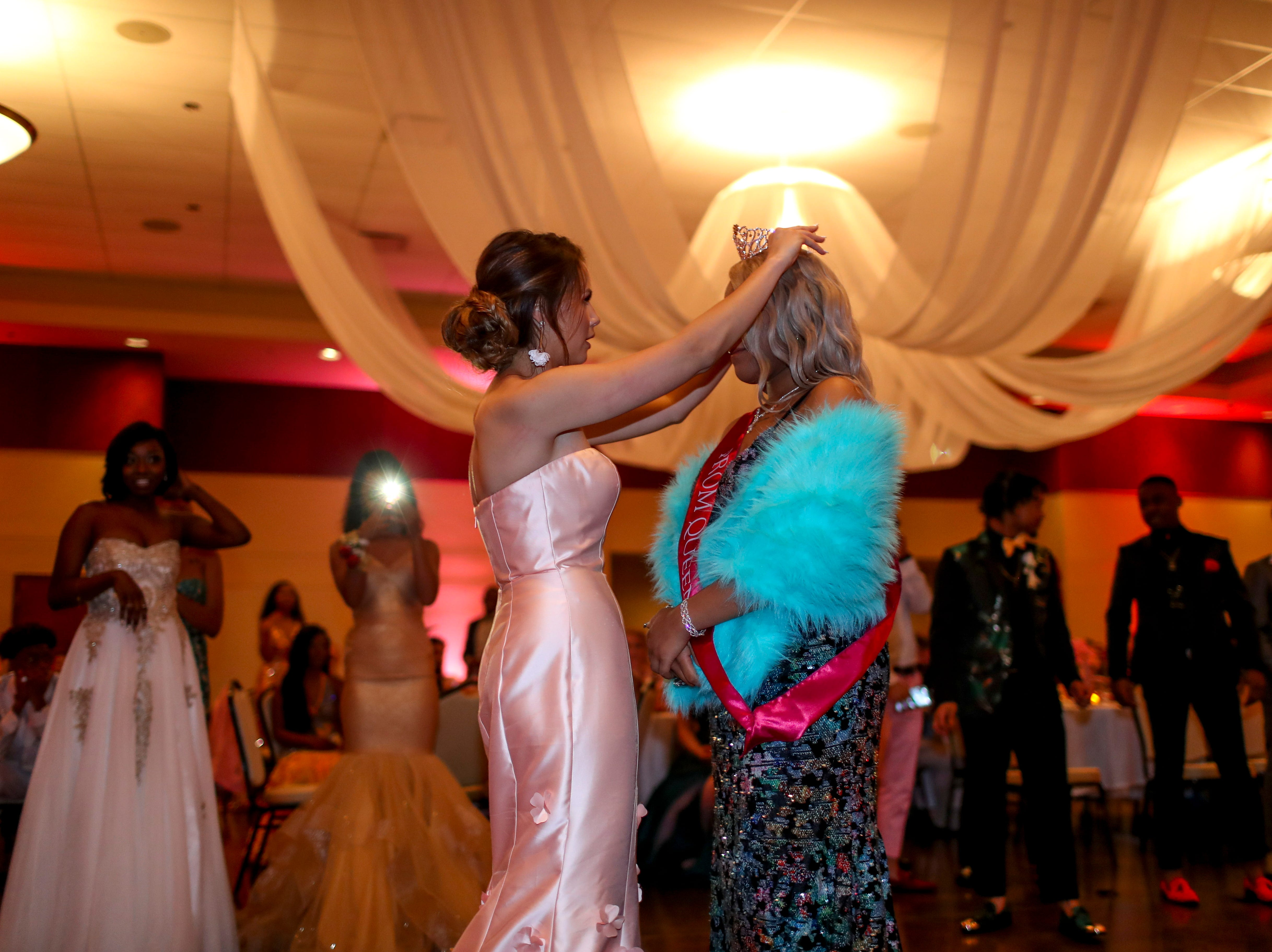 """Adannis Delis-Luna is crowned prom queen while hundreds of students from Kenwood High School celebrated their 2019 prom themed """"Cherish the Moment"""" at Valor Hall in Oak Grove, KY., on Saturday, May 4, 2019."""