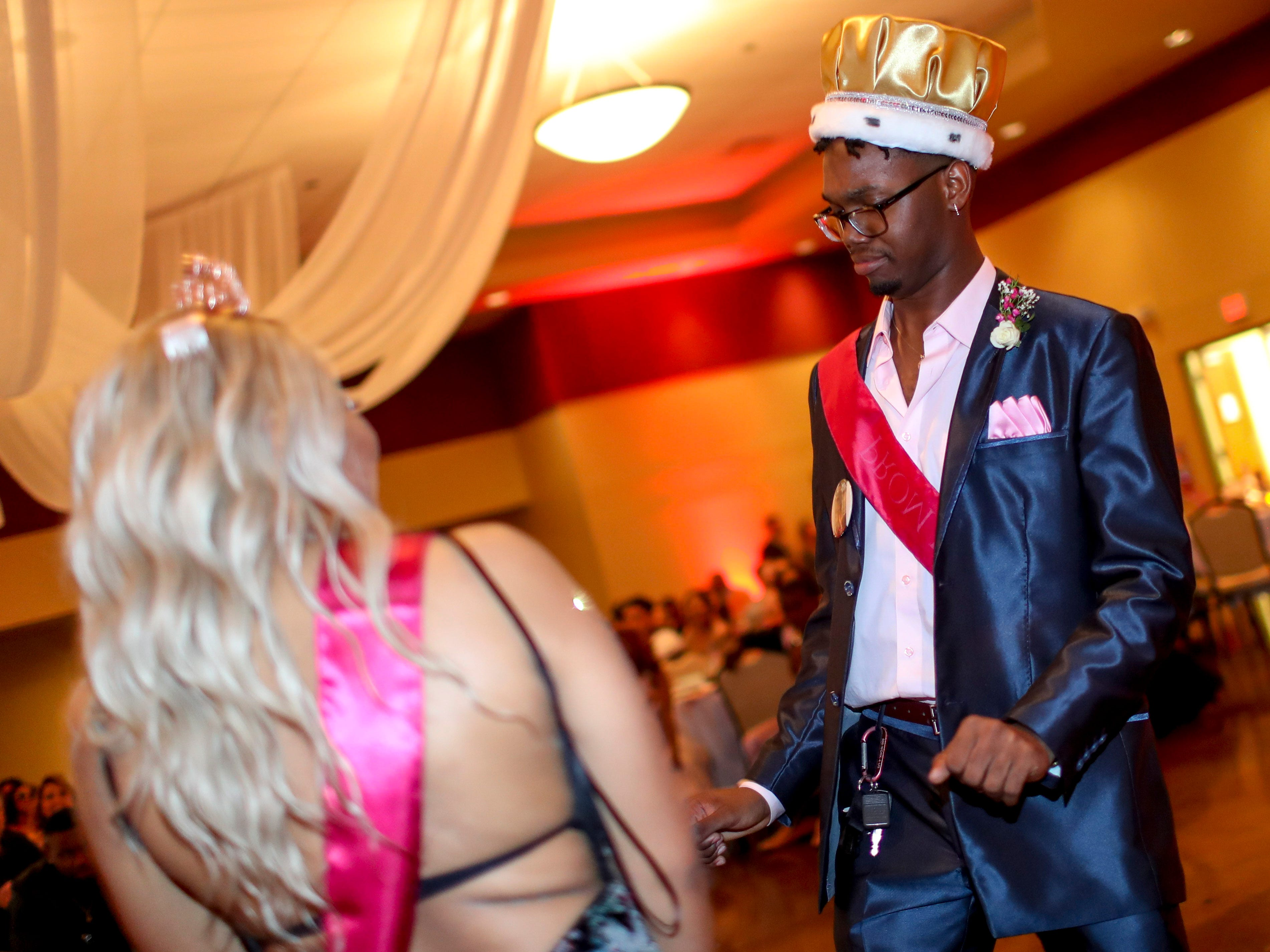 """Prom king Kaos Armstrong, right, dances with prom queen Adannis Delis-Luna as hundreds of students from Kenwood High School celebrated their 2019 prom themed """"Cherish the Moment"""" at Valor Hall in Oak Grove, KY., on Saturday, May 4, 2019."""