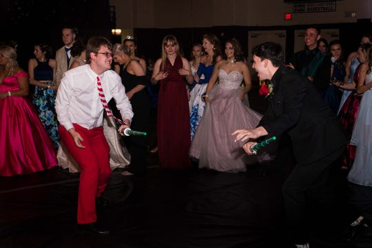 In recognition of May the Fourth, Griffin Swanberg and Keeton Hicks have a Star Wars light saber battle at Stewart County High School's prom on Saturday night, May 4, 2019.