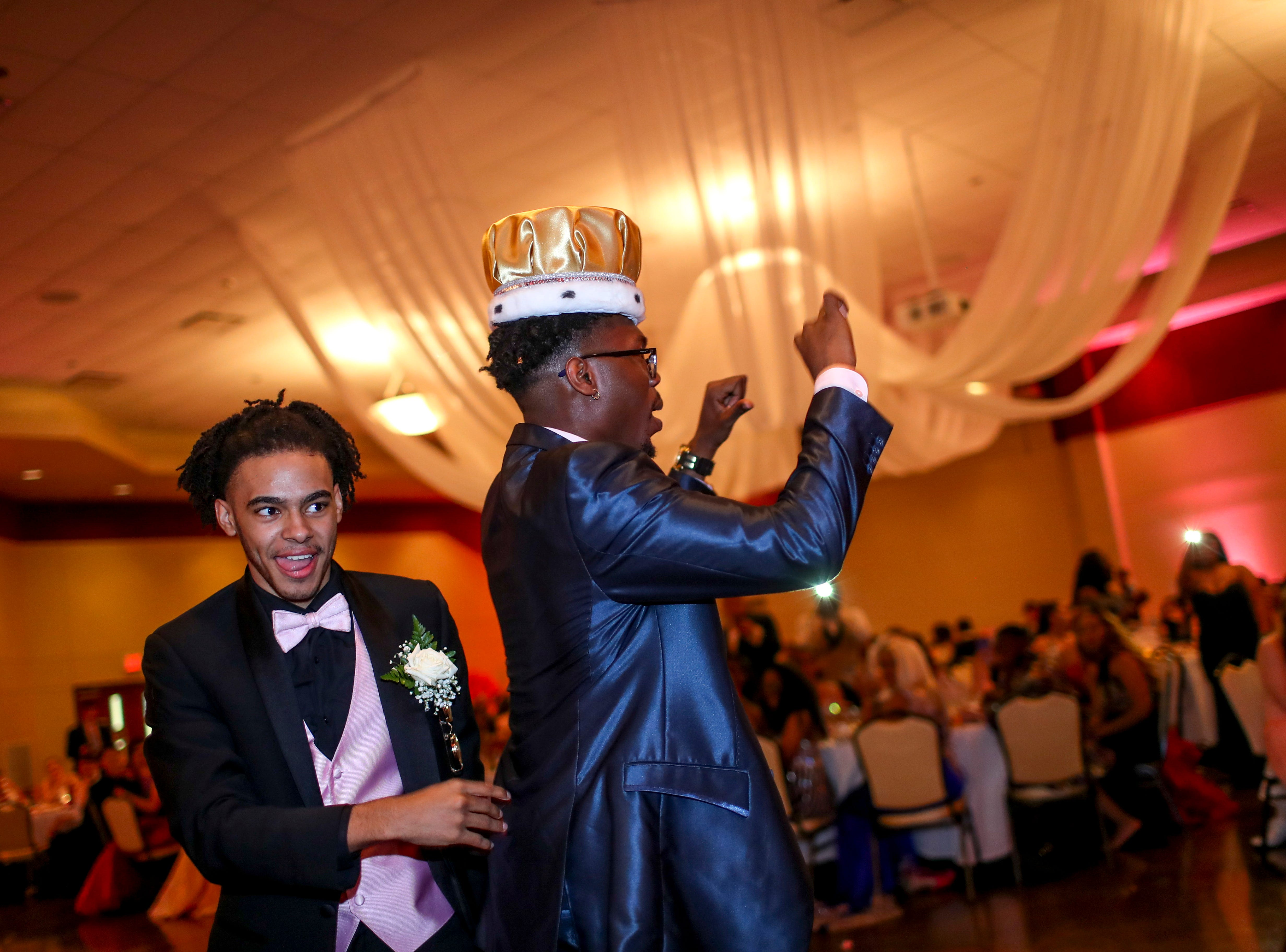"""Prom king Kaos Armstrong dances to the crowd after being crowned while hundreds of students from Kenwood High School celebrated their 2019 prom themed """"Cherish the Moment"""" at Valor Hall in Oak Grove, KY., on Saturday, May 4, 2019."""