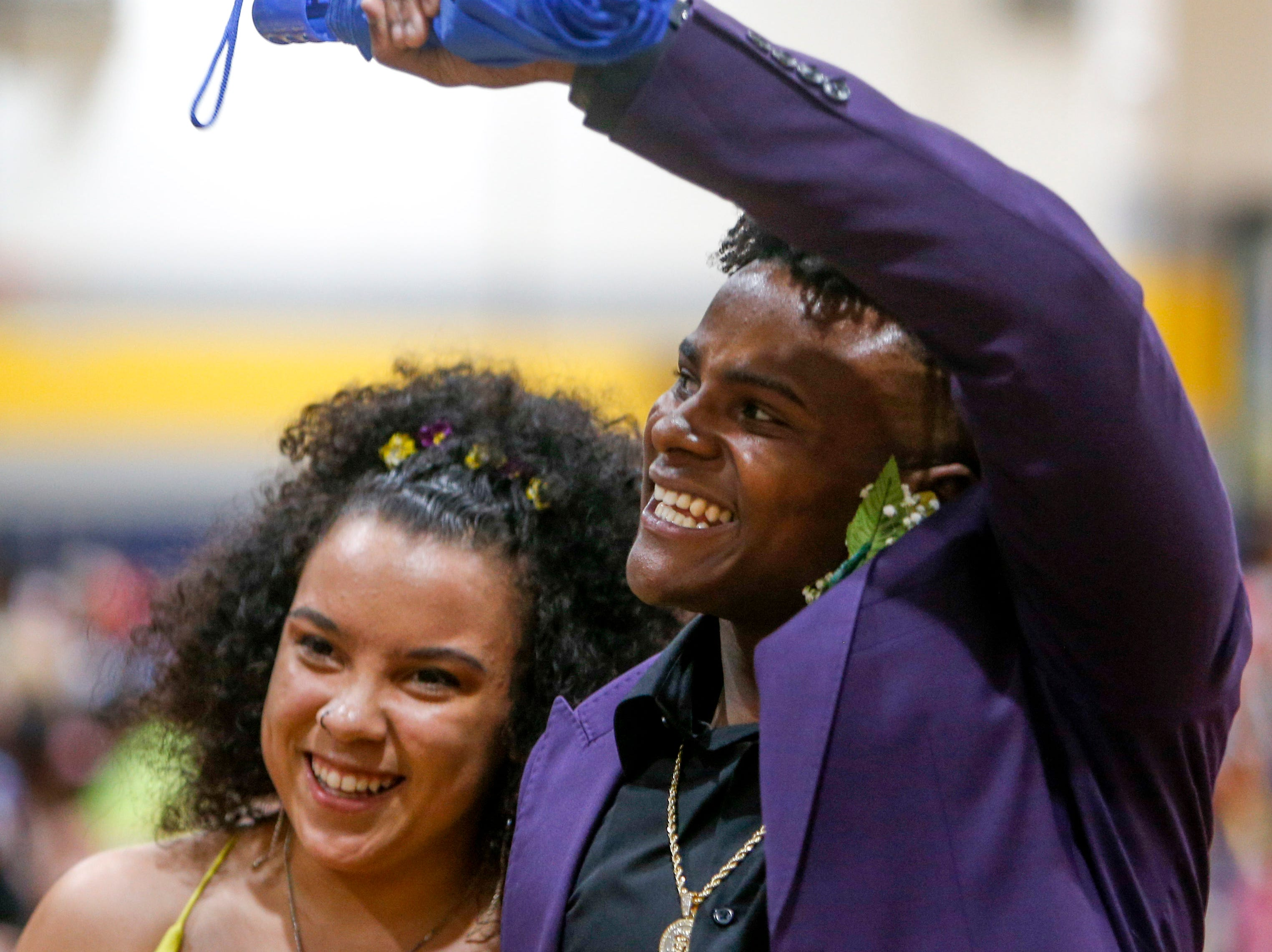 Hundreds of students from Northeast braved the foul weather and walked a red carpet on their way to busses that will take them to Opryland for their 2019 prom at Northeast High School in Clarksville, Tenn., on Saturday, May 4, 2019.