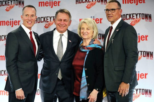 From left, Christopher Ilitch, Ken Holland, Marian Ilitch and new Detroit Red Wings GM Steve Yzerman pose for a photo following a press conference Friday, April 19, 2019, at Little Caesars Arena in Detroit.