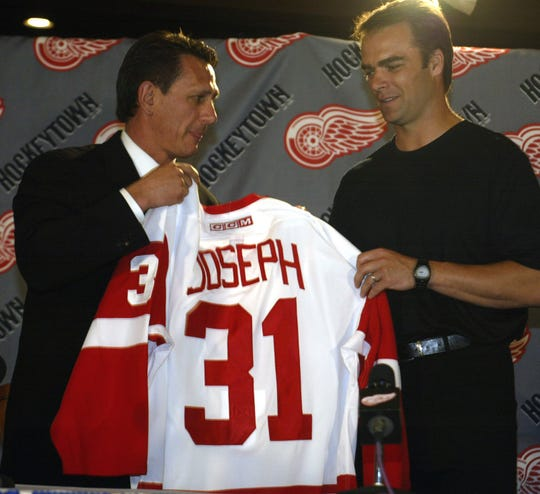 Caption: Detroit Red Wings GM Ken Holland welcomes goalie Curtis Joseph to the team on July, 2, 2002.