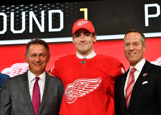Filip Zadina, middle, poses with GM Ken Holland, left, and owner Chris Ilitch, after being selected as the No. 6 overall pick to the Detroit Red Wings in the first round of the 2018 NHL Draft at American Airlines Center in Dallas on June 22.