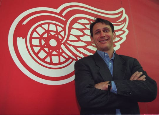 Ken Holland, General Manager of the Detroit Red Wings, stands aside their team logo at Joe Louis Arena, Thursday, Oct. 16, 1997.