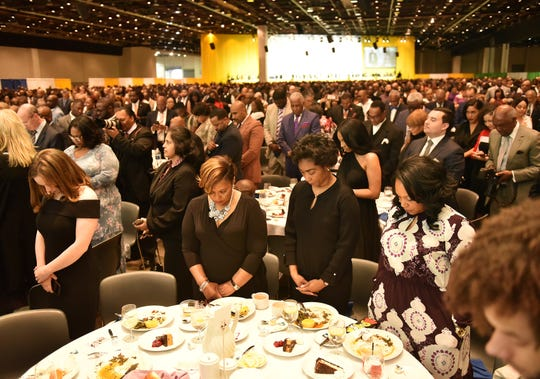 Attendees pause for a moment of silence for the late Judge Damon Keith at the NAACP 64th Annual Fight For Freedom Fund Dinner at Cobo Center in Detroit on May 5, 2019.