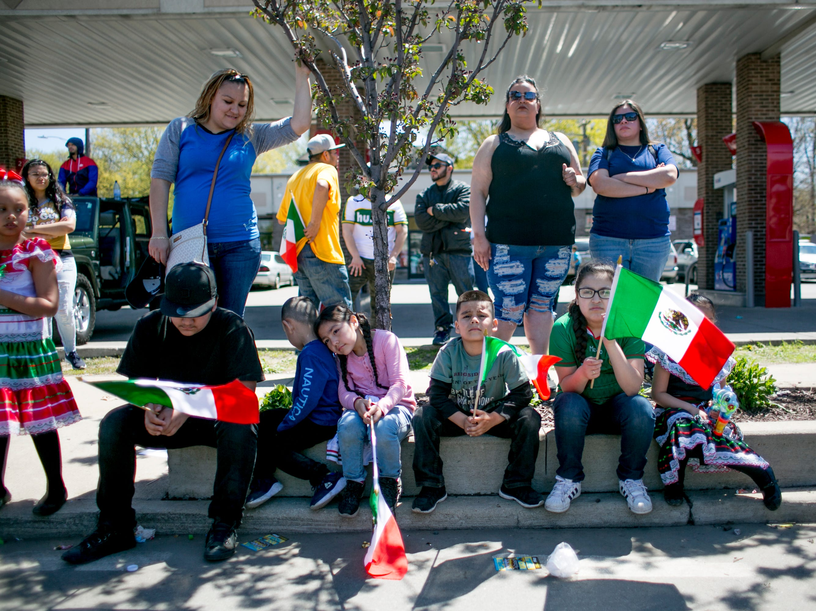 People watch  the 55th Annual Cinco de Mayo parade along Vernor Highway in southwest Detroit.