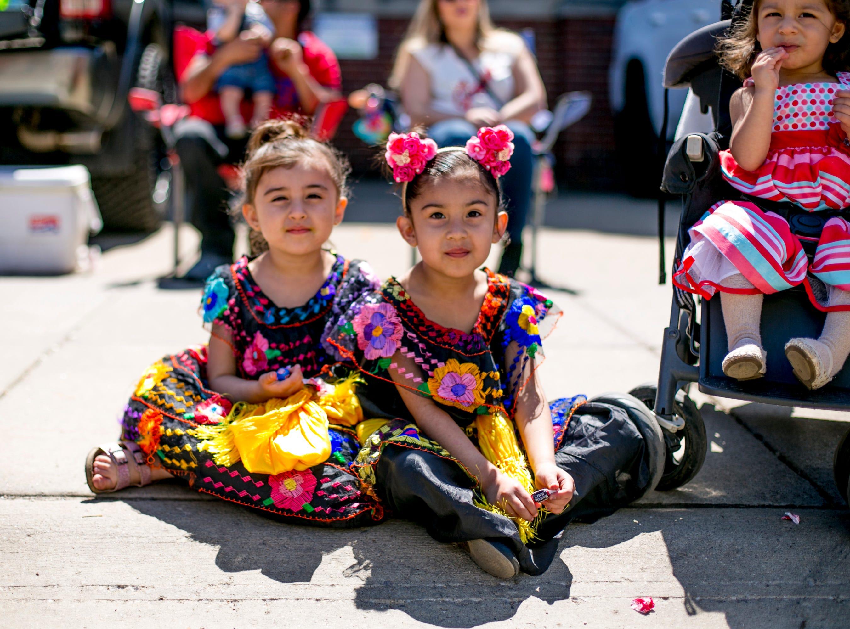 Mireily Macias and Valentina of Detroit watch the 55th Annual Cinco de Mayo parade along Vernor Highway.