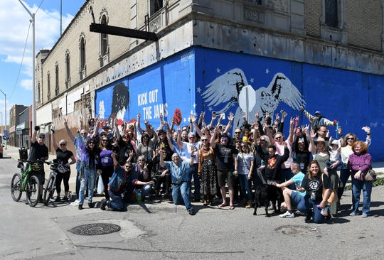 A group photo is taken as people gather to celebrate the life of Russ Gibb outside the Grande Ballroom in Detroit on Sunday.