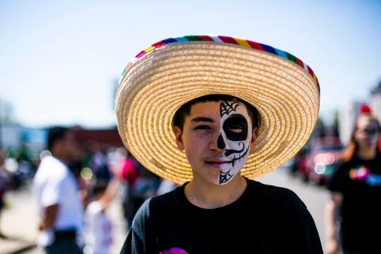 13-year-old Alex Lowe of Detroit walks in the 55th Annual Cinco de Mayo parade.