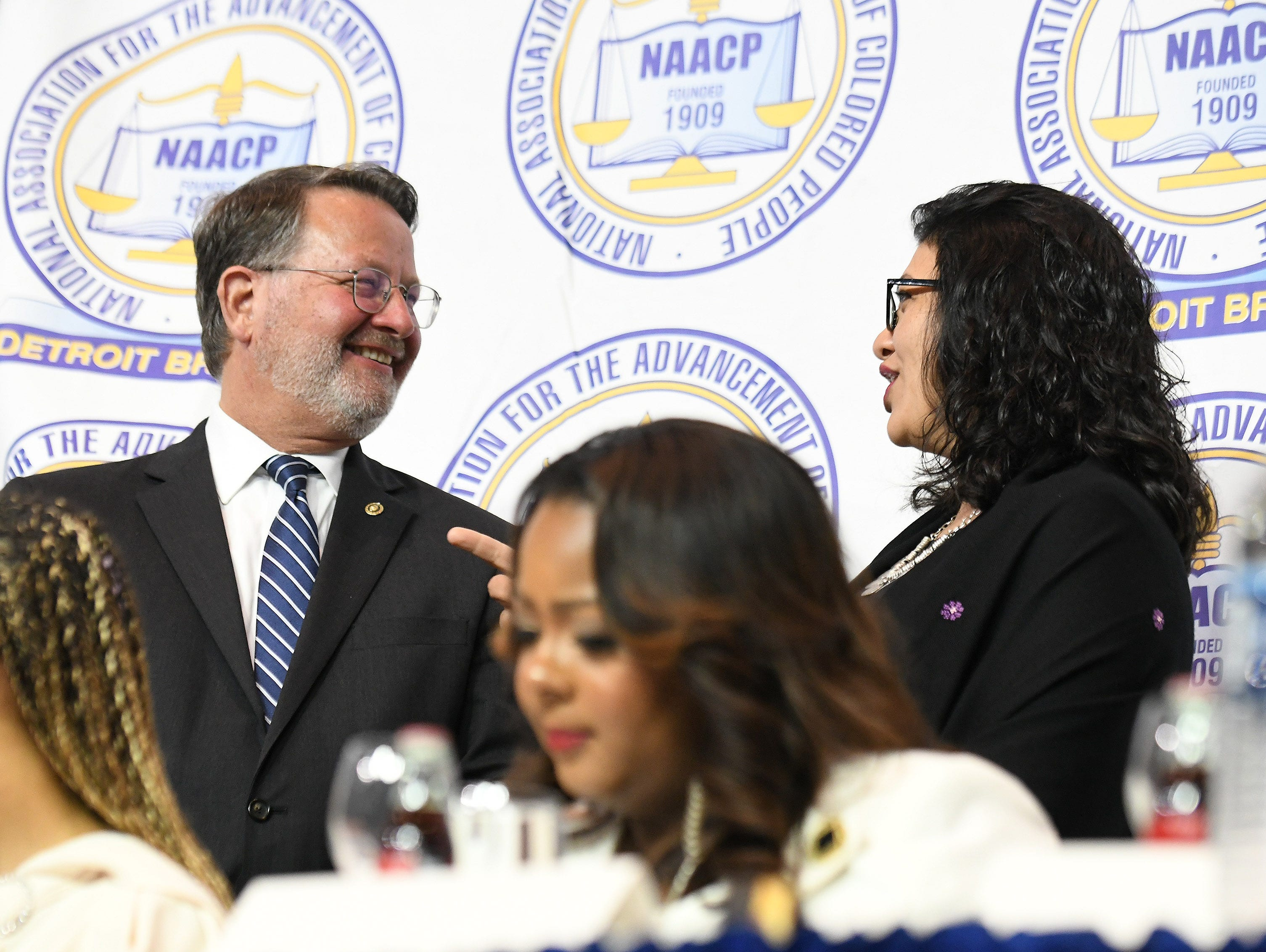 U.S. Sen. Gary Peters, left, with U.S. Rep. Rashida Tlaib, right, at the NAACP 64th Annual Fight For Freedom Fund Dinner at Cobo Center.
