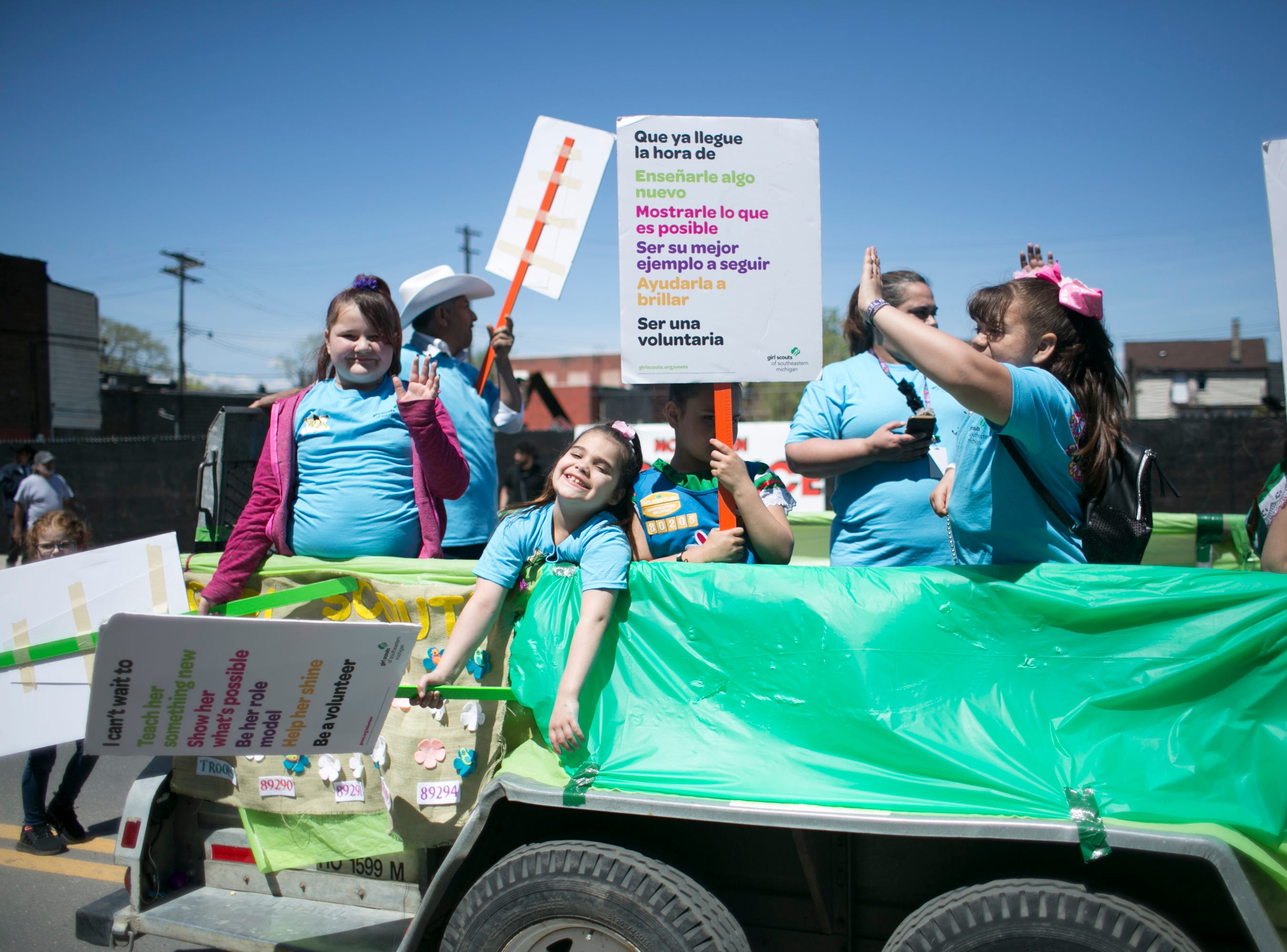 The Girl Scouts ride in the 55th Annual Cinco de Mayo parade along Vernor Highway.
